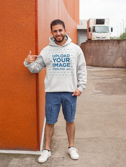 Mockup of a Man Pointing at His Heathered Pullover Hoodie 27628