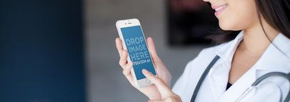 iPhone Mockup Featuring a Female Doctor at a Hospital a6130