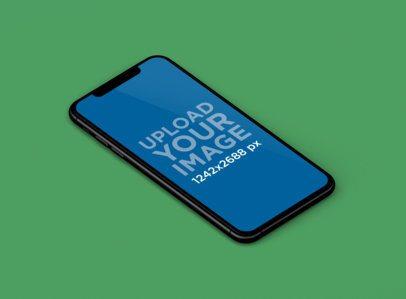 Mockup of an iPhone XS Max Lying in a Color-Custom Backdrop 242-el
