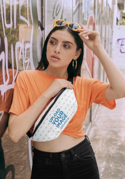 Fanny Pack Mockup Featuring a Young Woman Leaning Against a Graffitied Wall 29196