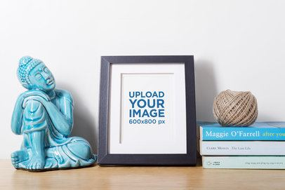 Mockup of a Photo Frame on a Shelf with Intellectual Stuff 589-el