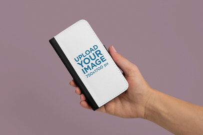 Mockup of a Hand Holding a Wallet Case for iPhone X 29249