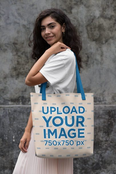 Tote Bag Mockup of a Woman in Front of a Concrete Wall 29448