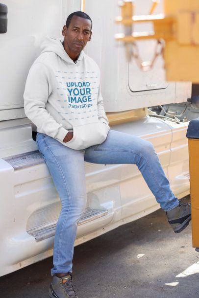 Pullover Hoodie Mockup of a Man Leaning on a Truck Cabin 29463