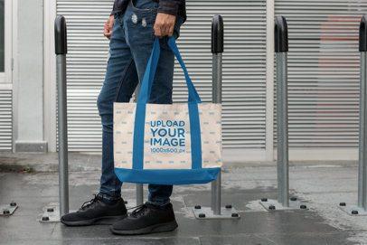 Weekend Bag Mockup of a Man Standing by Some Bike Racks 29799