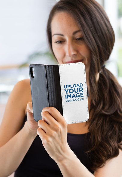 Wallet Case Mockup of a Woman Scrolling Through Her iPhone X 29811