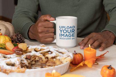 Mockup of a Man Holding a 15 oz Mug at a Thanksgiving Party 29938