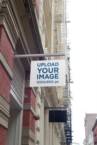 Mockup of a Shop Sign at a Fancy Street 680-el