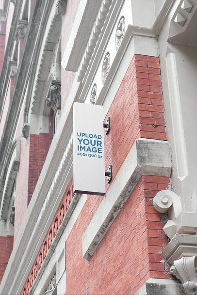 Shop Sign Mockup Featuring a Vertical Sign at a Brick-Wall Building 689-el