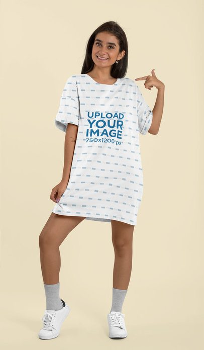 Mockup of a Woman Pointing at Her Shift Dress at a Studio 29756