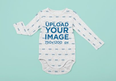 Sublimated Long Sleeve Onesie Mockup Placed over a Flat Surface 29838