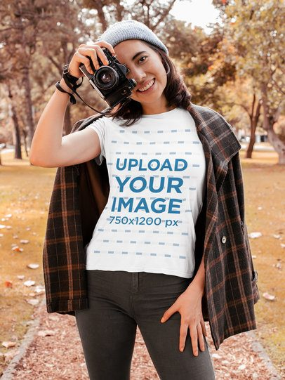 T-Shirt Mockup of a Young Woman Taking Pictures at a Park 30118