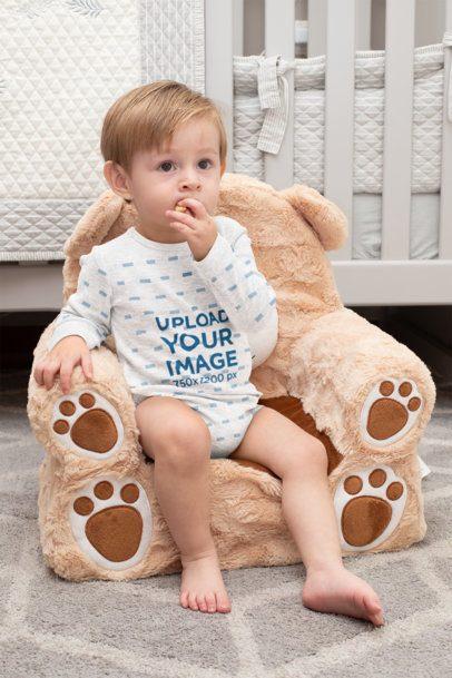 Heathered Onesie Mockup of a Little Boy Sitting on a Teddy Bear Chair 29999