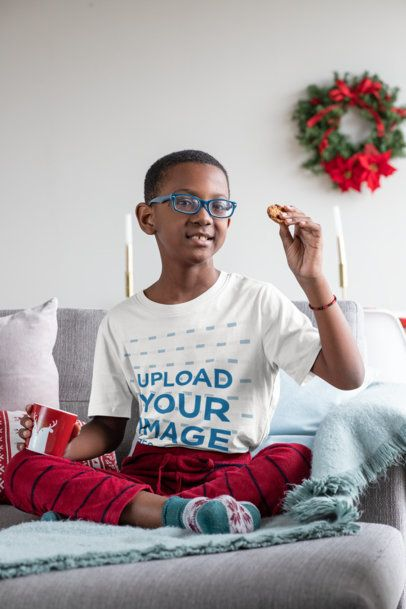 T-Shirt Mockup Featuring a Kid with Glasses at a Xmas Decorated Living Room 30342