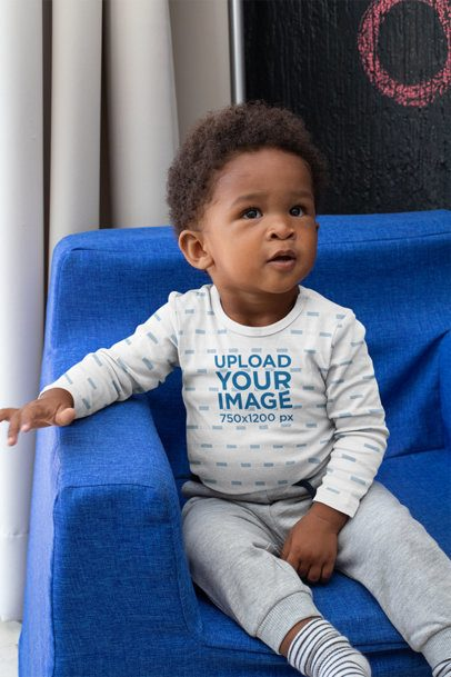 Long Sleeve Onesie Mockup of a Baby Boy Sitting on a Couch 30033