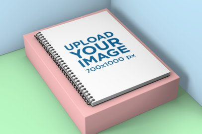 Mockup of a Spiral Notebook on a Small Pedestal 1005-el