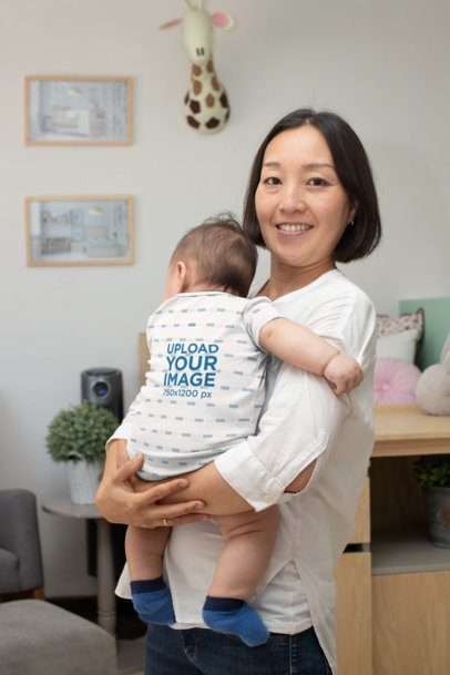 Onesie Mockup of a Woman Holding Her Baby at Home 30006