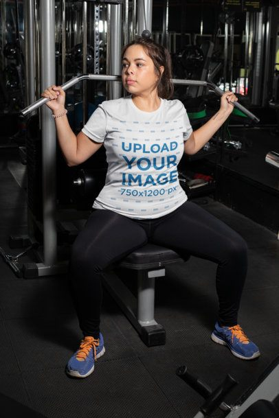 Plus Size T-Shirt Mockup Featuring a Woman Doing Pull Downs at a Gym 30144