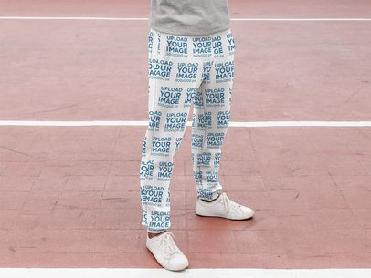 Sublimated Sweatpants Mockup Featuring a Man at a Running Track 29852