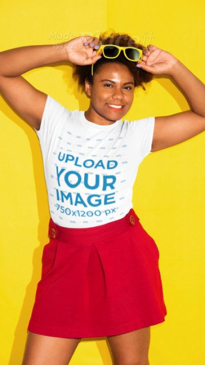 T-shirt Video of a Joyful Woman Posing in Front of a Solid Color Backdrop 22846