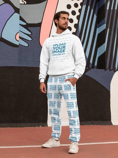 Hoodie Mockup of a Bearded Man Wearing Sweatpants Against a Graffiti Wall 29850