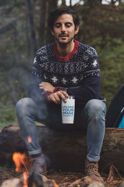 Mockup of a Man at a Campfire Drinking from a Tumbler 30477