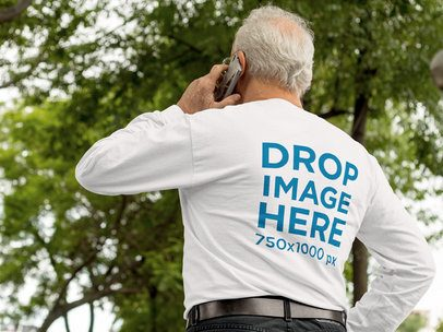 Mockup of the Back of an Elder Man Wearing a Long-Sleeve T-Shirt While Talking on his Phone b10942