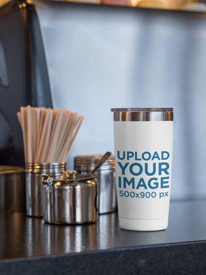 20 oz Travel Mug Mockup Placed by Stainless Steel Kitchen Containers 30390