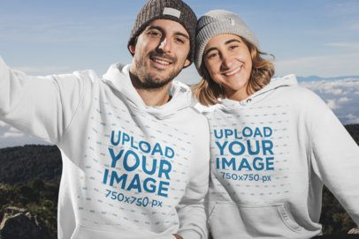 Mockup of Two Friends at the Mountain Wearing Pullover Hoodies 30490