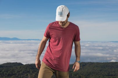 Mockup of a Man at a Hiking Trail Wearing a Customizable Dad Hat 30480