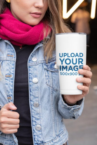 Mockup of a Cropped Face Woman Holding a 30 oz Travel Mug in the City 30422