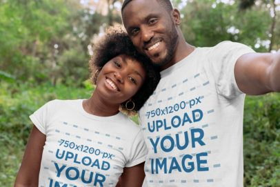 Mockup of a Tender Couple Wearing Customizable T-Shirts at a Park 30613