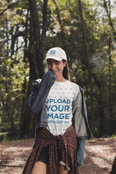 T-Shirt Mockup of a Woman Wearing a Dad Hat in the Woods 30463