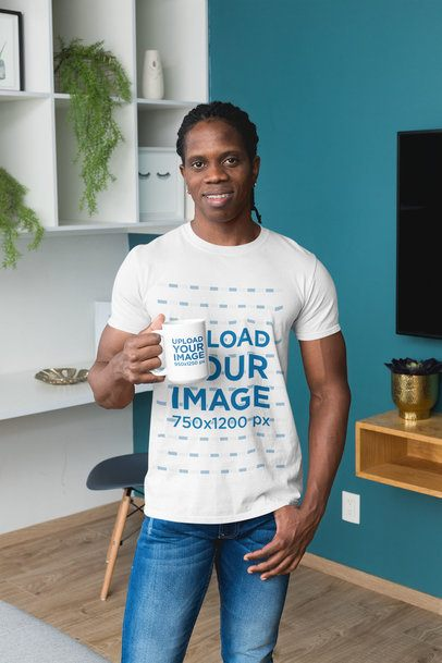 T-Shirt Mockup of a Man in the Living Room Holding a 15 oz Mug 30311