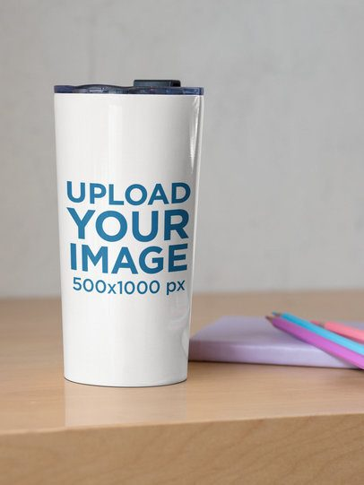 Mockup of a 20 oz Travel Mug Placed by Some Colored Pencils 30409