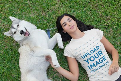 T-Shirt Mockup of a Woman Lying on the Grass with Her Dog 30660