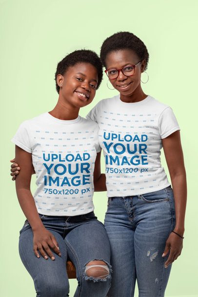 Mockup of a Mother and Daughter Wearing Matching T-Shirts at a Studio 30615