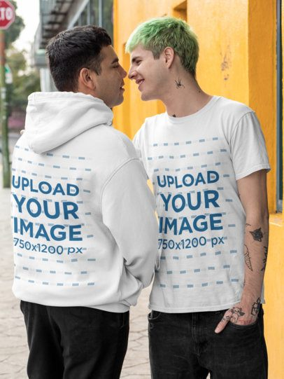 Mockup of an LGBT Couple Wearing a Hoodie and a Tee in an Urban Scenario 30443