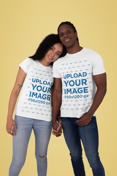 T-Shirt Mockup Featuring a Couple Holding Hands in a Studio 30761