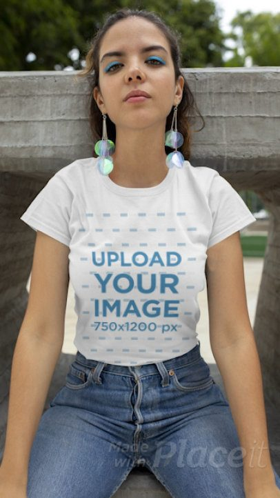 T-Shirt Video Featuring a Young Woman Sitting on a Concrete Structure 22719