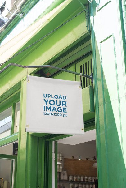 Mockup of a Squared Store Sign Placed on a Green Building 1407-el