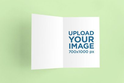 Mockup of an Open Greeting Card Placed on a Flat Surface 942-el