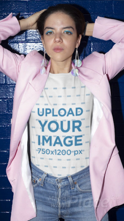 T-Shirt Video Featuring a Young Woman Posing Against a Blue Brick Wall 22717