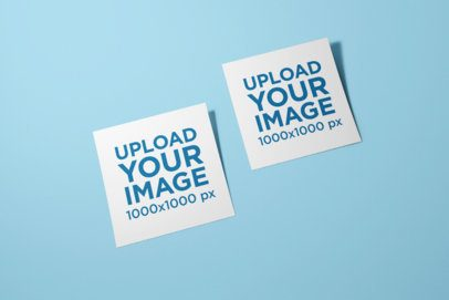 Mockup of Two Squared Flyers Lying on a Color-Customizable Surface 1748-el