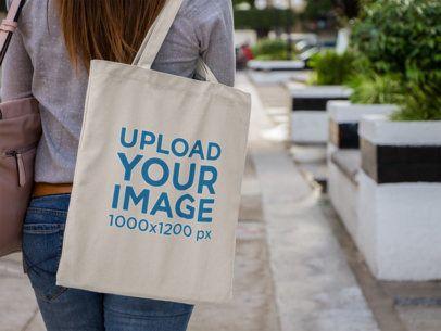 Canvas Tote Bag Mockup Over a Woman's Shoulder a11492