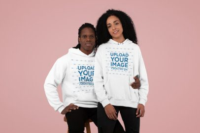 Pullover Hoodie Mockup of a Smiling Couple at a Studio 30772