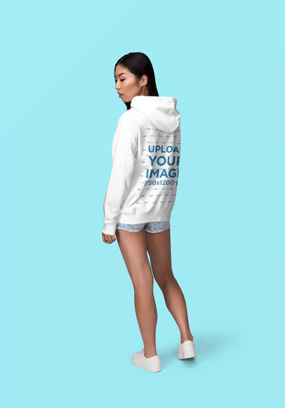 Back View Mockup of a Young Woman Wearing a Hoodie and Posing at a Studio 1867-el1