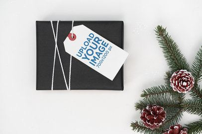 Mockup of a Brand Tag Attached to a Christmas Present 2087-el1