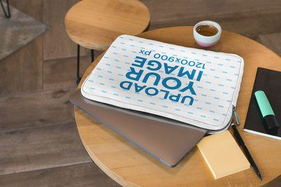 Mockup of a Sublimated Laptop Sleeve over a Wooden Table 30869