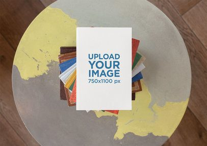 Mockup of a Book on a Pile of Colorful Books 30915